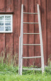 Wooden ladder and wall of old farmhouse — Stock Photo