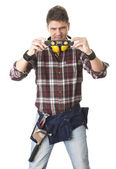 Male builder with work tools holding level — Stock Photo