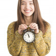 Attractive young woman holding alarm clock — Stock Photo