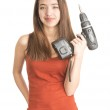 Attractive young woman holding cordless screwdriver — Stock Photo