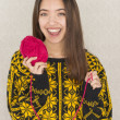 Stock Photo: Attractive young woman holding a ball of yarn