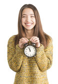 Joven atractiva con reloj despertador — Foto de Stock