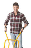 Happy man with cart used for transport — Foto Stock