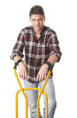 Positive man with cart used for transport — Stock Photo