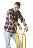 Smiling man with cart used for transport — Stock Photo