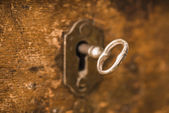 Vintage key in lock of wooden chest — Stock Photo