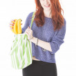 Happy woman put fruit in eco friendly cloth bag — Stock Photo
