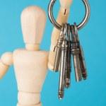 Wood doll holding set of retro keys — Stock Photo #25127135