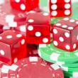 Poker chips and red casino dice — Stock Photo