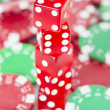 Poker chips and red casino dice — Stock Photo #29917089