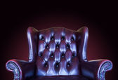 Old vintage red leather chair on gradient background — Stock Photo