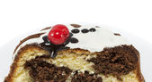Marble cake with cherry isolated on white — Stock Photo