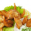 Fried prawns in coconut breading with dipping sauce on white iso - 图库照片