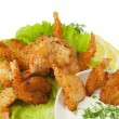 Fried prawns in coconut breading with dipping sauce on white iso - Stockfoto