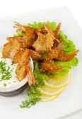 Fried prawns in coconut breading with dipping sauce — Stock Photo