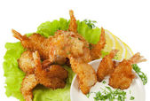 Fried prawns in coconut breading with dipping sauce on white iso — Stock Photo