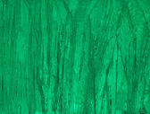 Texture of ice with dark green back light. — Stock Photo