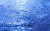 Texture of ice with dark blue back light. — Stock Photo