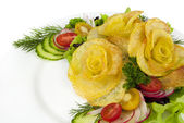 French fries in the form of a rose on a plate with a salad on wh — Stock Photo