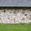 Fragment of the wall of the house put from big granite stones — Stock Photo #27359121