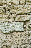 Old vintage stone wall as background — Stock Photo