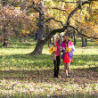 Two beautiful girls  walk in autumn park — Stock Photo