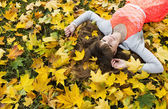 Beautiful girl with long dark hair in autumn park — Stock Photo