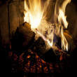 Stock Photo: Fire burning in fireplace.