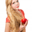 Attractive teen girl in the orange t-shirt holding an red apple — Stock Photo #46672005