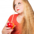 Attractive teen girl in the orange t-shirt holding an red apple — Stock Photo #46672009