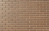 Modern brick wall in a bright sunny day as background — Foto Stock