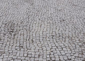 Street  cobbled by granite stones as background — Stock Photo