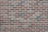 Wall from the made old brick as background — Stock Photo