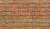 Wall from a red brick with a corrugated pattern as background — Stock Photo