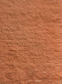 Texture of the red rough plastered wall — Stock Photo