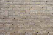 The creative gray brick wall with pig-iron rivets as background — Foto Stock