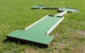 Small golf course built for children in a recreational space. — Stock Photo