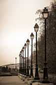 A quiet street in Paris with lamp posts in a row — Stock Photo