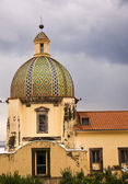 Church of Santa maria Assunta with dark clouds — Stock Photo