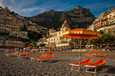 View of Positano beach with orange deck chairs — Stock Photo