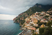 View of Positano beach with storm clouds — Stock Photo