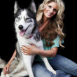 Stock Photo: WomWith AmericHusky