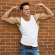 Flexing Bodybuilder — Stock Photo