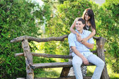 Young happy couple spending time in a park — Stockfoto