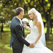 Happy young bride and groom dancing together outside on their we — Stock Photo #12882883