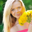 Stock Photo: Pretty girl with dandelions