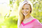 Beautiful smiling lady in spring — Stock Photo