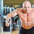 Stock Photo: Bodybuilder training in gym
