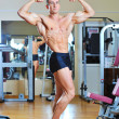 Fitness man in gym - full length portrait — Stock Photo