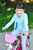Happy young girl with bicycle - outdoors — Stock Photo